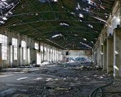 The interior of a run-down, abandoned industrial facility.
